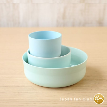 multiple sizes of light blue plates and bowls