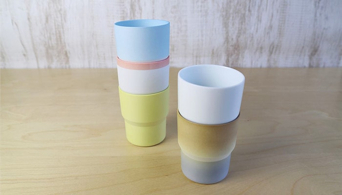 colorful gradation of stacked mugs