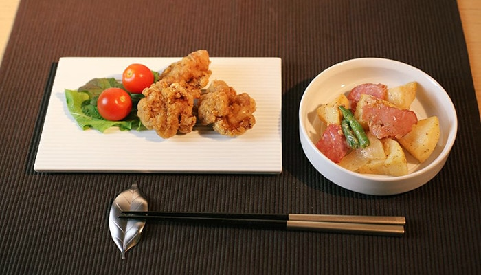 Japanese dinner with white serving platter and white bowl of SUI series