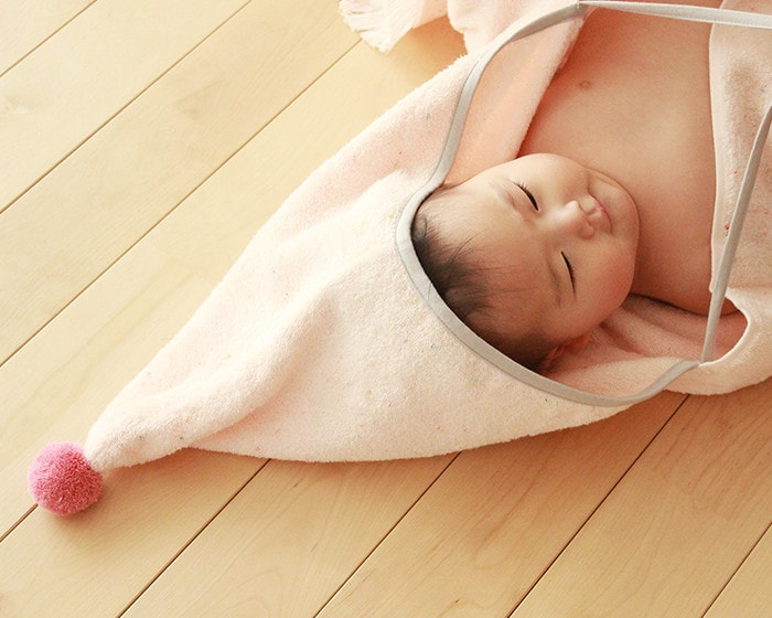 Using baby poncho as bath towel