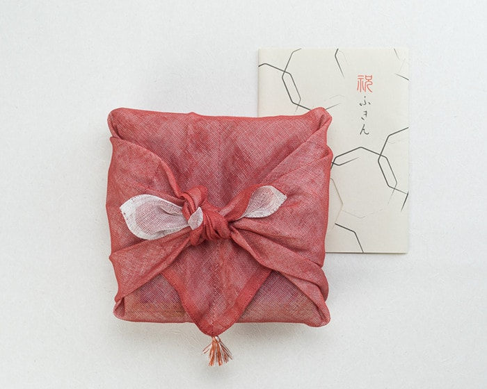 Arita deep dish wrapped with red and white dish cloth