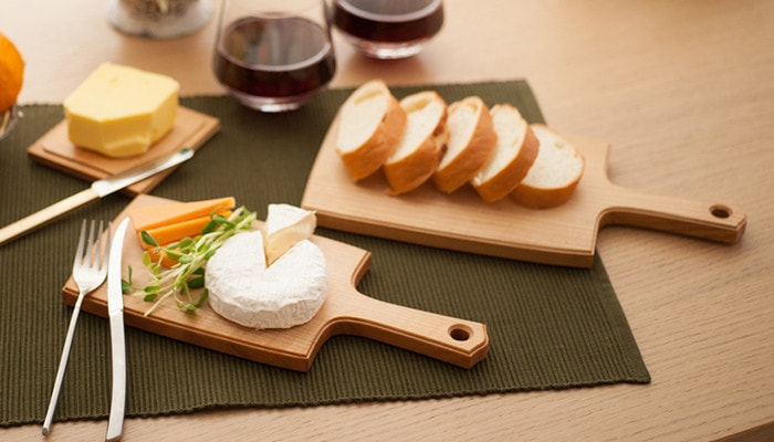 Cheese and bread on the wooden cheese board