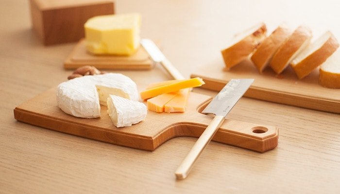 Cheese and bread dinner on wooden cheese board
