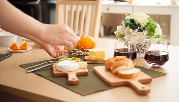 Table setting with wooden cheese board and other items
