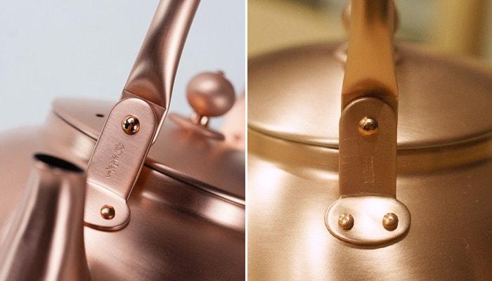 Logo of Azmaya and Sinkoudo on the handle of copper tea kettle