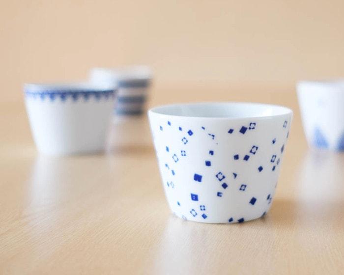 Omotenashi with tea in soba choko cups of Azmaya
