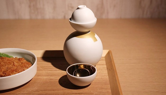 When you take a cup of Shuki daruma, you can see smaller sake cup inside