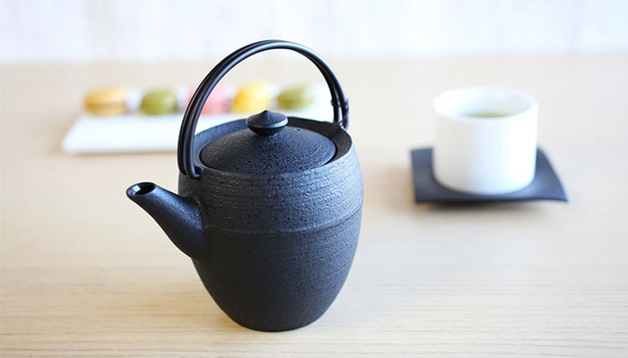 pleasant tea time with casting teapot