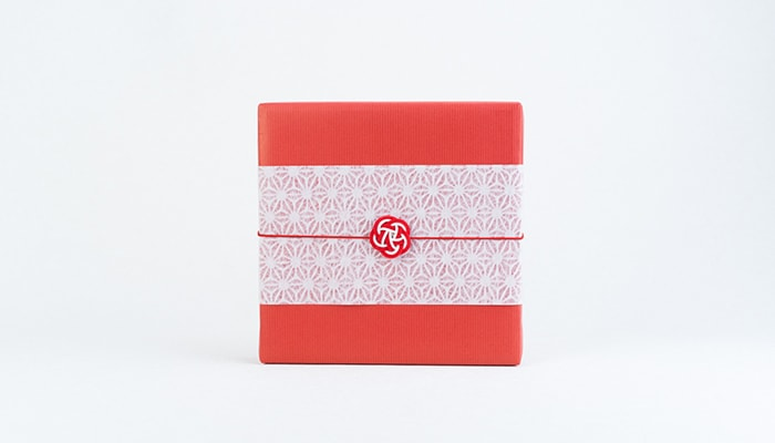 Image of Japanese gift wrapping with red wrapping paper and Japanese Ume Mizuhiki