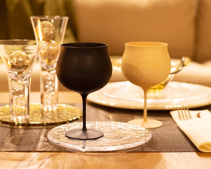 Wooden wine glasses from Gato Mikio on a glass plate
