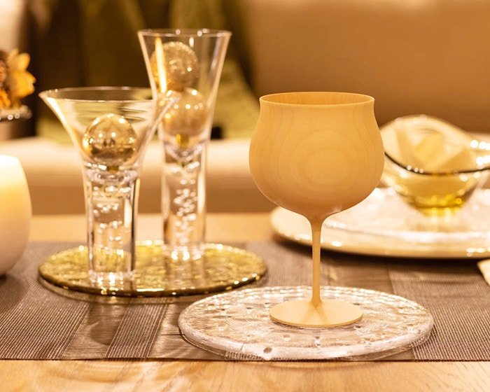 Plain wooden wine glass on a glass plate
