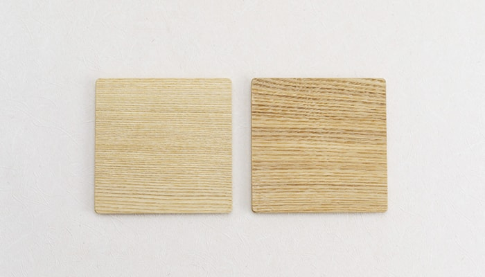 The wooden coasters of pair set of tea glasses