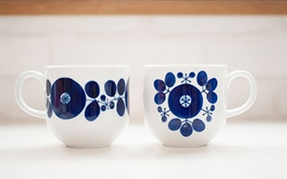 Retro design blue and white cups and mugs of Bloom series