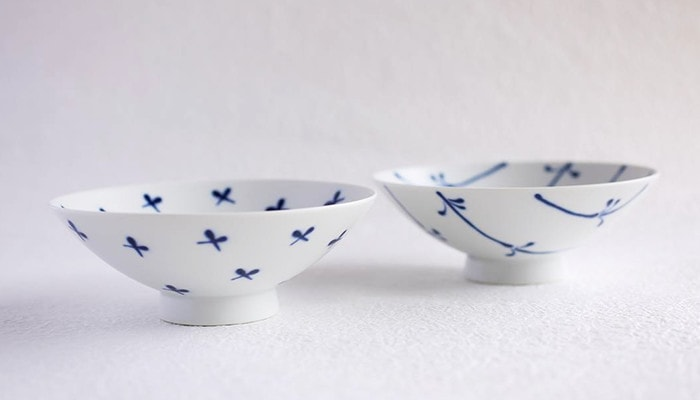 A pair of white and blue Japanese rice bowls