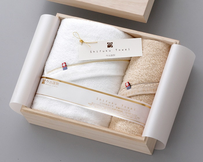 Fluffy towels set within exclusive wooden box