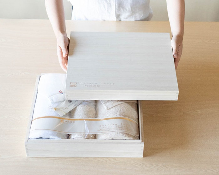 A big wooden box of fluffy towel set