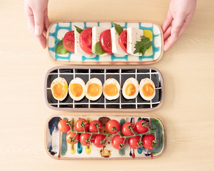 Caprese salad, boiled egg, and mini tomatoes on Rectangle L plates of Yachimun