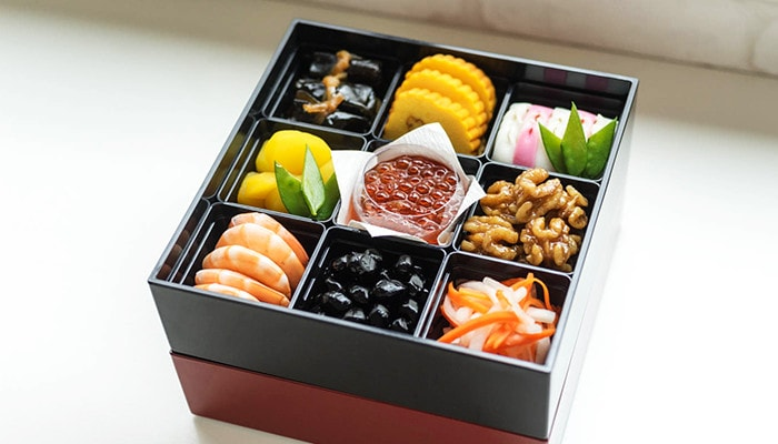 Beautiful food presentation with partition cups in Jubako box