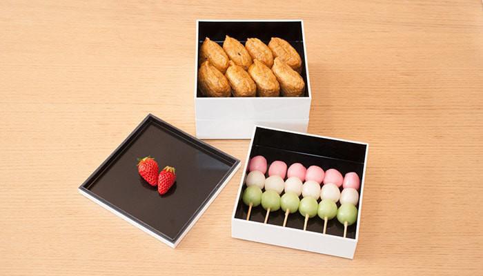 Hanami dumpling, Inari sushi and strawberries in Jubako boxes