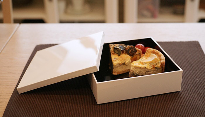 A Jubako box with a piece of quiche