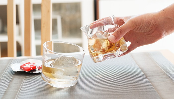 Toast with unique whiskey glasses