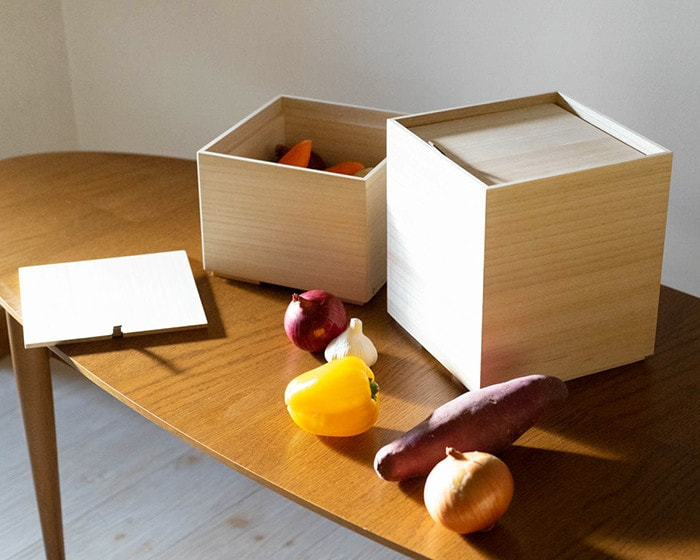 Kitchen vegetable storage boxes and vegetable on the table
