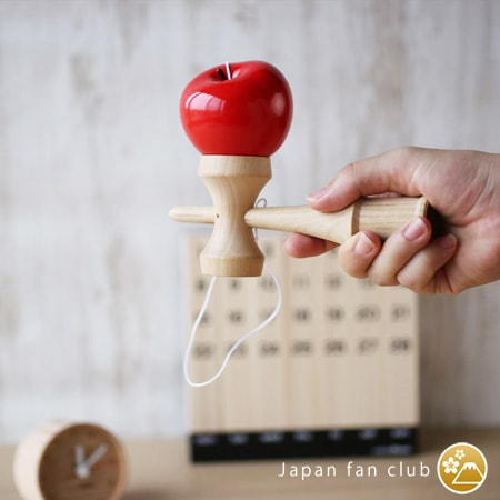 Bright red color of apple kendama