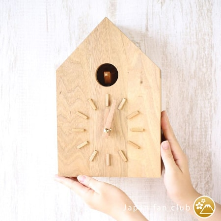 modern cuckoo clock hung on the wall