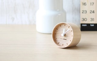 Wooden table clocks calmly tick like an annual ring of a tree
