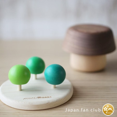 Wooden spinning tops of more Trees and wooden mushroom bowls of Sunao lab behind the tops
