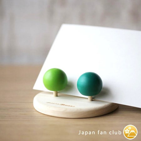 Wooden spinning tops as a letter stand