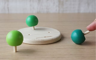 Wooden spinning tops will grow Japanese forest