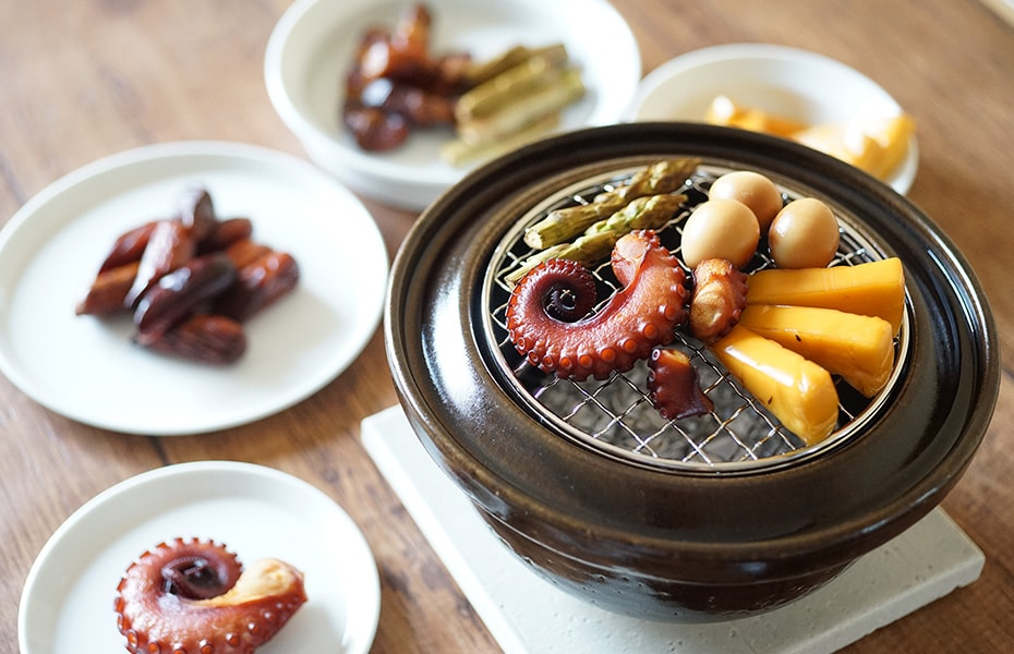 Smoked food on clay pot smoker Ibushigin
