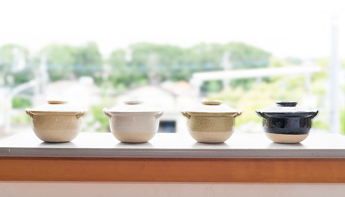 4 small Japanese clay pots on kitchen counter