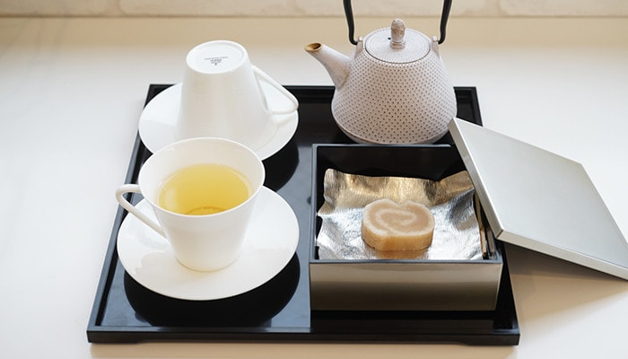 Tea time with Japanese confectionery in jubako and tea in cup of EXQUISITE