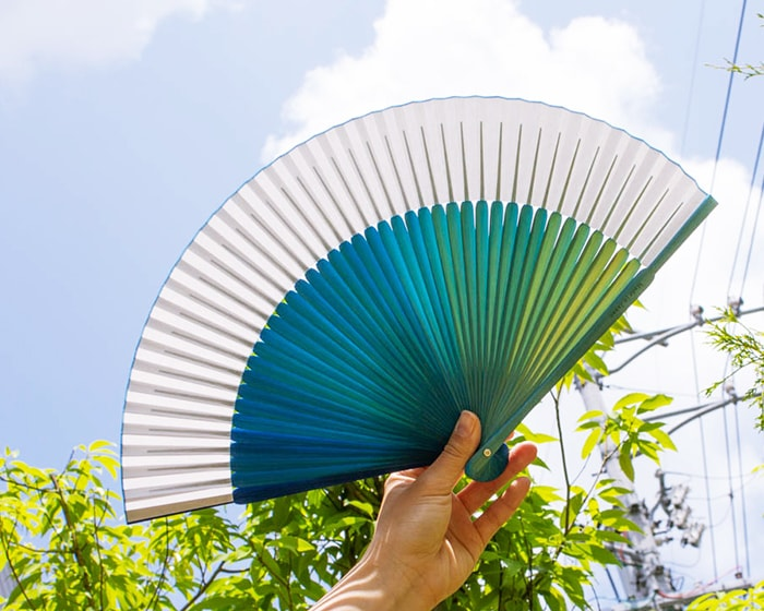 Blue color gradients of sticks of gradation fan