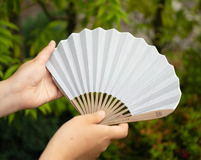 White and beige of Japangarde folding fan