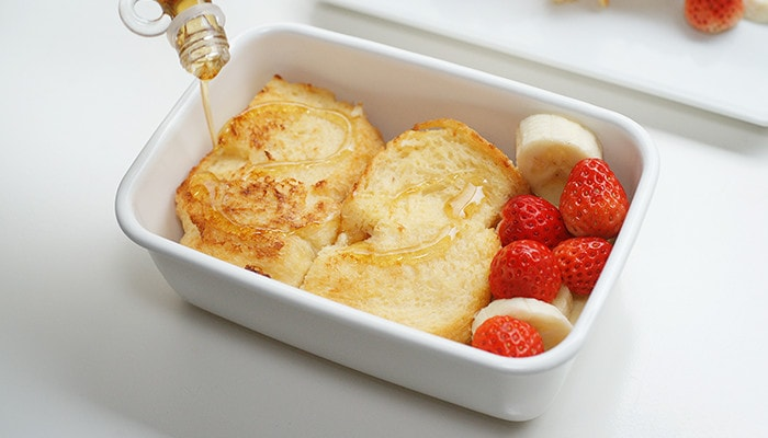 delicious lunch box with white enamel baking dish