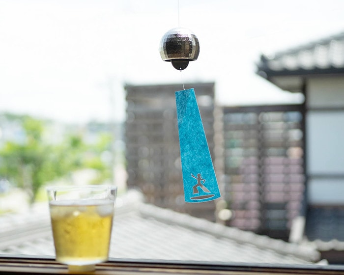 Disco ball wind chime from Nousaku and a glass of iced tea