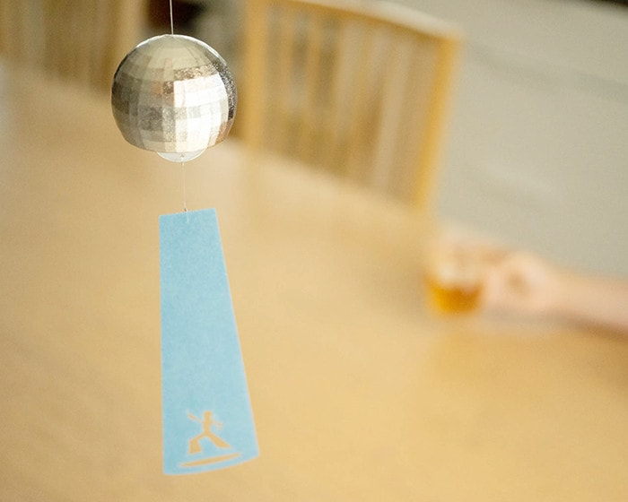 Disco ball wind bell above the table