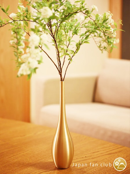 beautiful presence of metal vase with a single flower