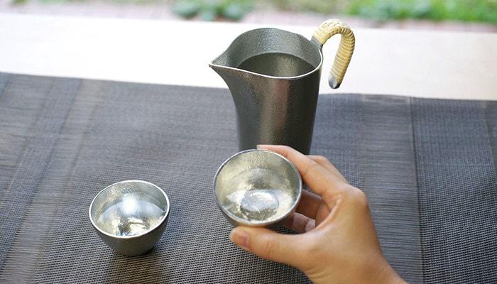 drinking hot sake with sake bottle Chirori and tin sake cup