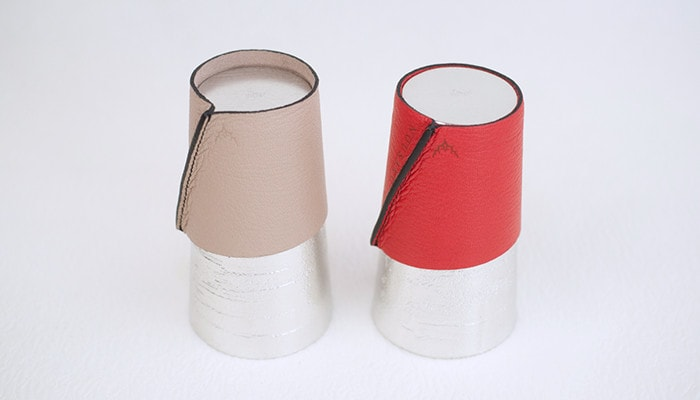 At first, the leather coffee sleeves are small like the beige sleeve. However, the leather will extend as time passes like the red sleeve.