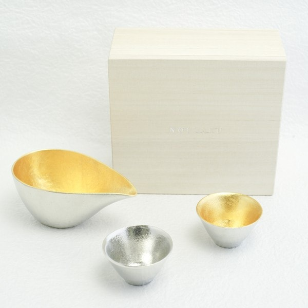 Sake cup set within paulownia box