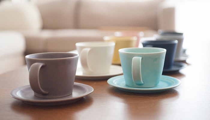 There are cups and saucers of DAYS series on the table