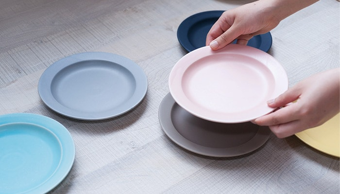 Plate M of DAYS series. A woman has pink plate