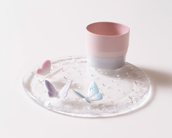 Espresso cup and butterfly chopsticks on droplet plate of Sugahara