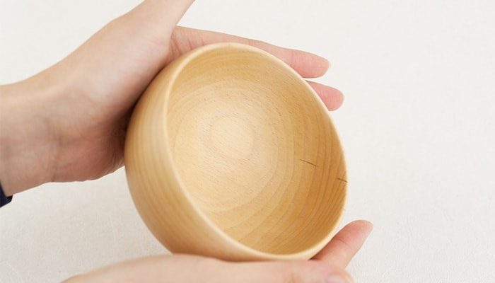Dark lines inside the wooden soup bowl
