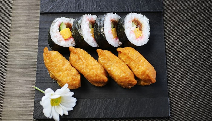 sushi looks more delicious on slate plate