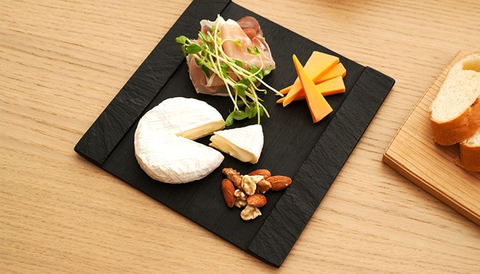 Snacks for alcohol on the slate cheese board